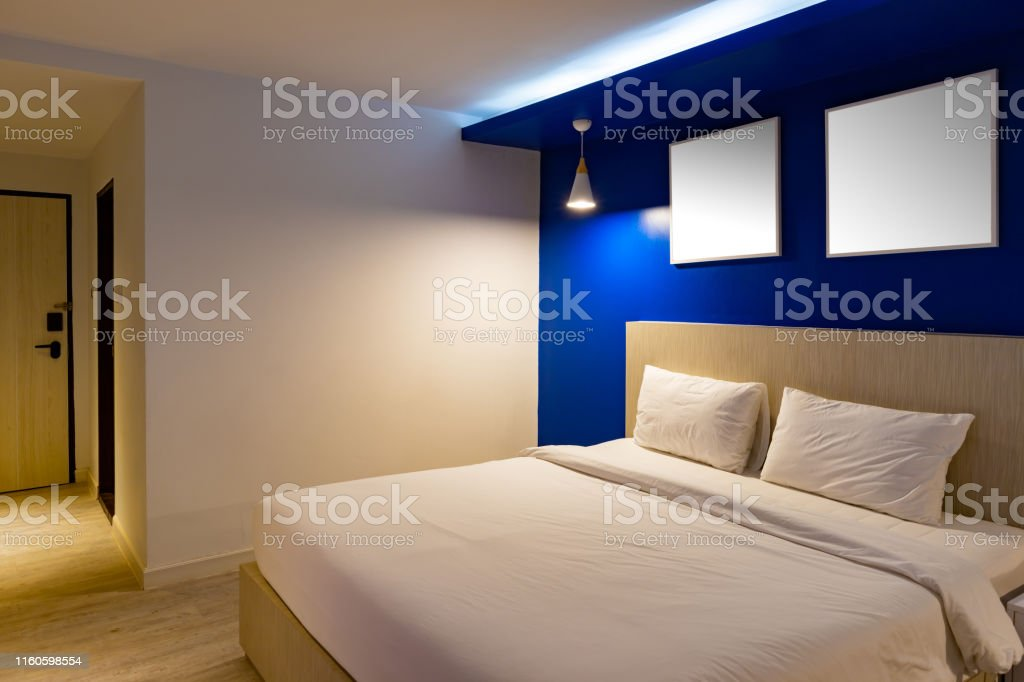 Dark blue tone interior of hotel room with wooden floor with sea view...