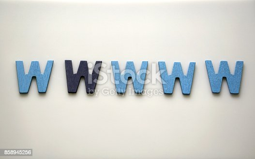 istock Dark blue W Alphabet letters of the English alphabet are lined on white background with empty space. Differrence in color concept. 858945256
