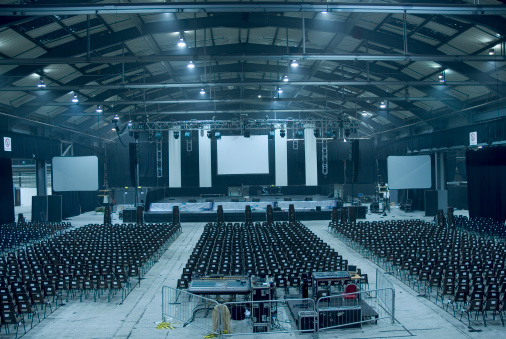 Dark blue-toned large empty auditorium hall
