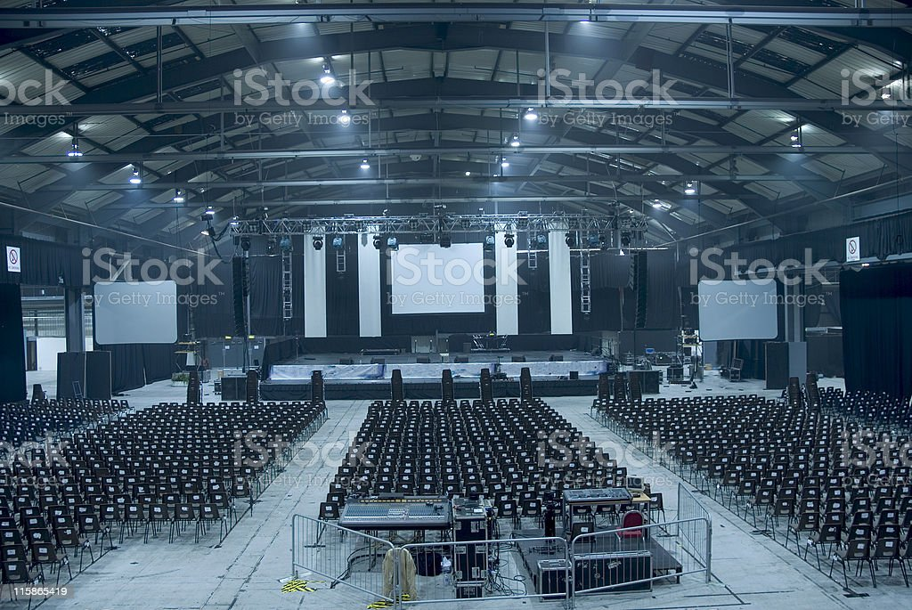 Dark blue-toned large empty auditorium hall stock photo