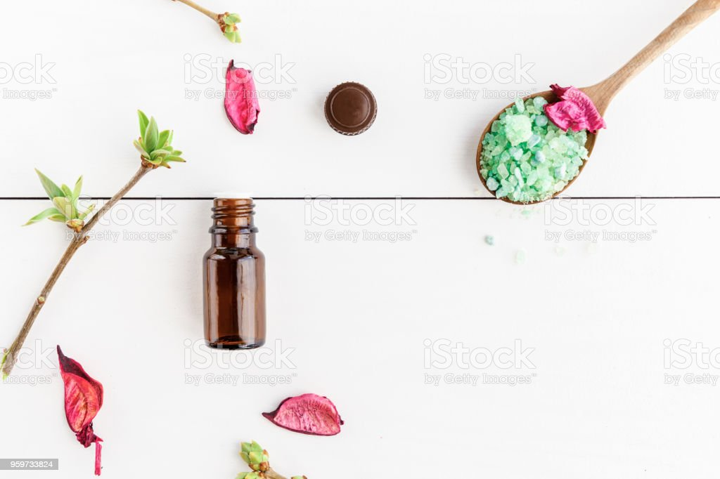 Dark bottle with essential oil dry flowers of a rose and green sea dark bottle with essential oil dry flowers of a rose and green sea salt mightylinksfo