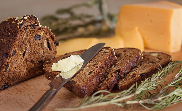 dark bread with butter and cheese stock photo