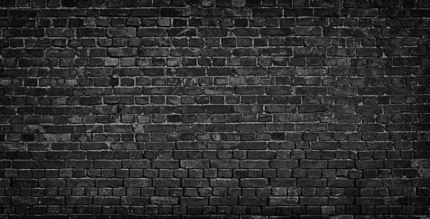 dark brick wall as a backdrop. brickwork design element stock photo