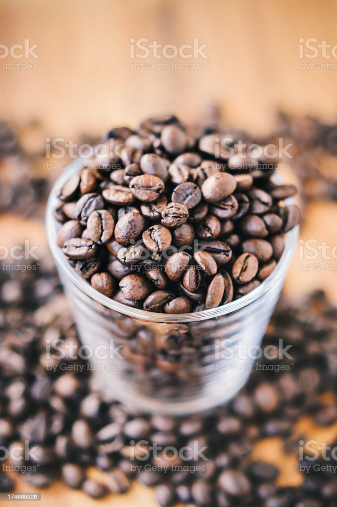 Dark brown coffee beans in a drinking glass royalty-free stock photo