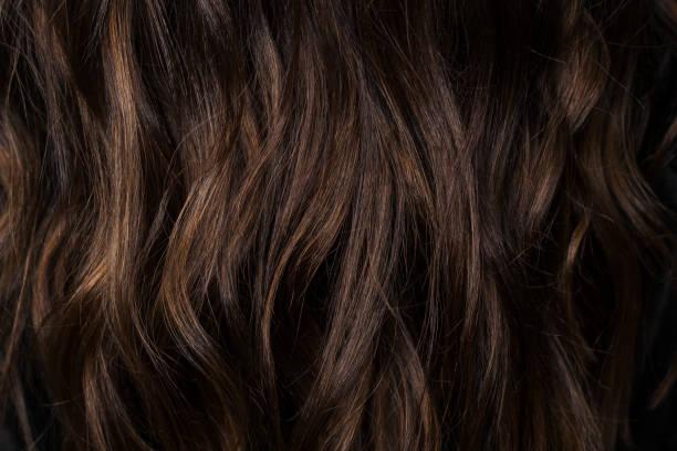 dark brown hair texture. wallpaper - capelli castani foto e immagini stock