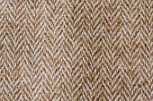 Dark brown herringbone fabric swatch.