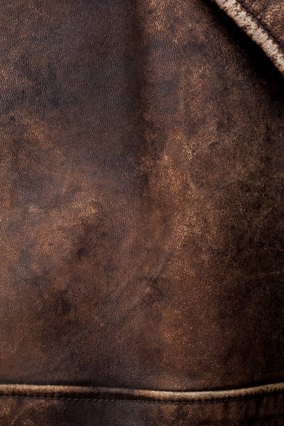 Dark brown leather background stock photo