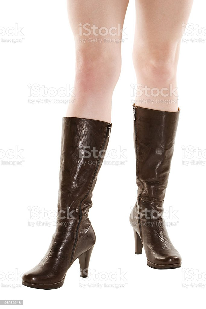 2c50794719 Dark brown leather boots on legs isolated over white background - Stock  image .