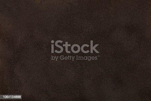 istock Dark brown matt suede fabric closeup. Velvet texture. 1064134888