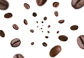 Dark brown roasted coffee beans falling on white background. Concept for coffee product advertising. Selective Focus.