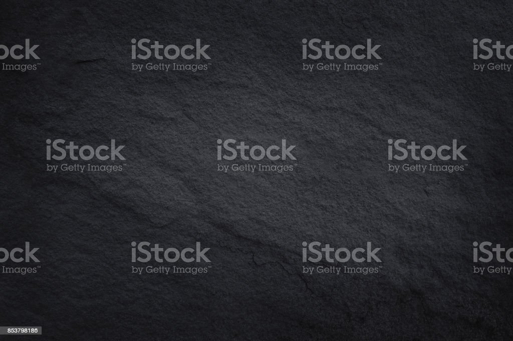 Dark brown slate texture in natural pattern with high resolution for background and design art work. Brown stone wall. stock photo