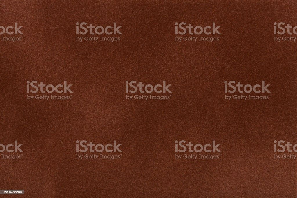 Dark brown suede fabric closeup. Velvet texture. stock photo