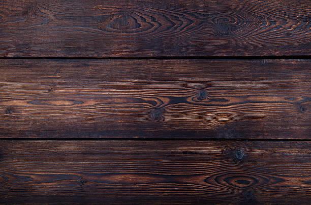 dunkelbraunes hölzerner hintergrund mit hoher auflösung. kopieren sie raum. - walnussholz stock-fotos und bilder