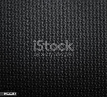 istock Dark bumpy plastic texture 136522263