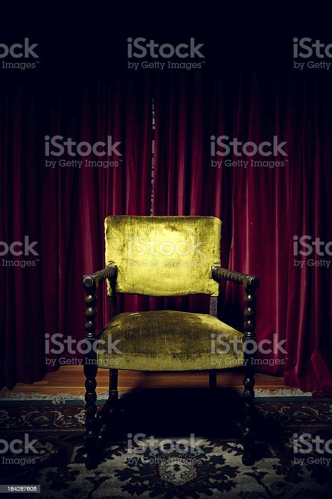 Dark Chair in Antique Room stock photo