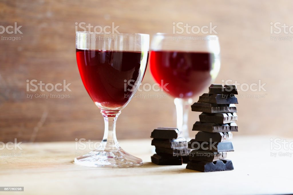 Dark chocolate and red wine on wooden background stock photo