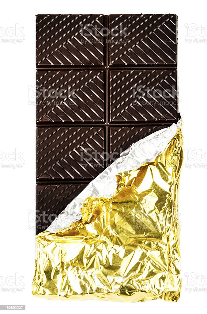 Dark Chocolate Bar in foil covers isolated on white background stock photo