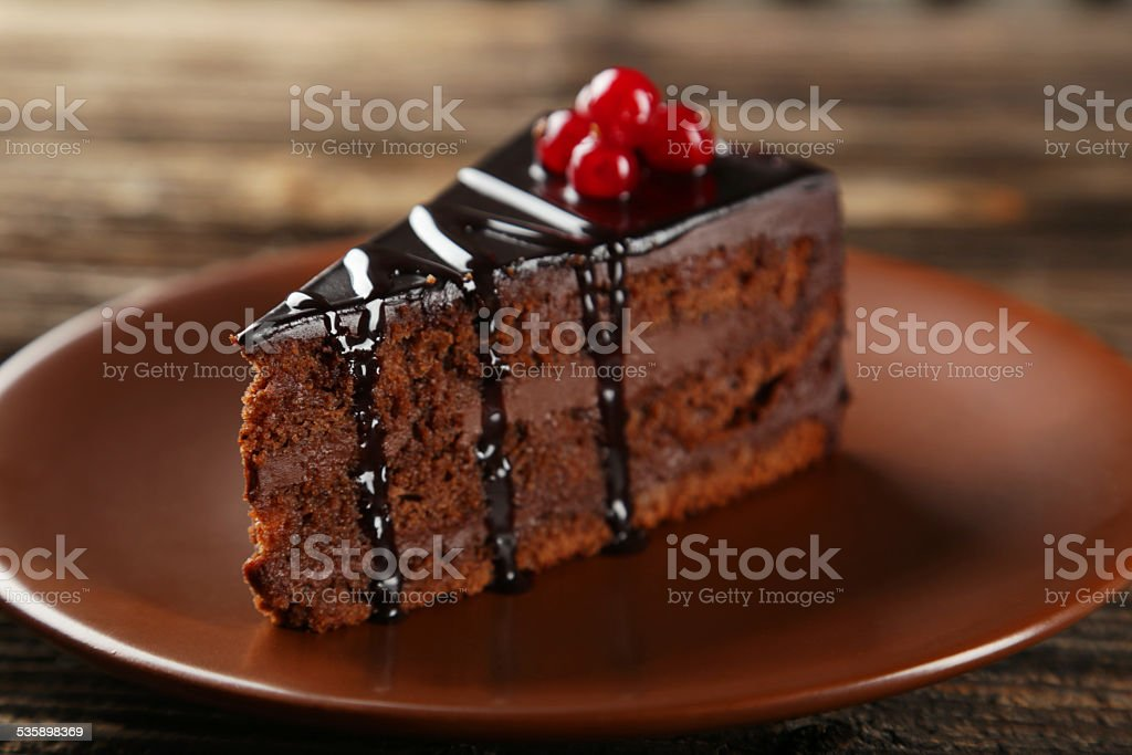 Dark chocolate cake on brown wooden background stock photo