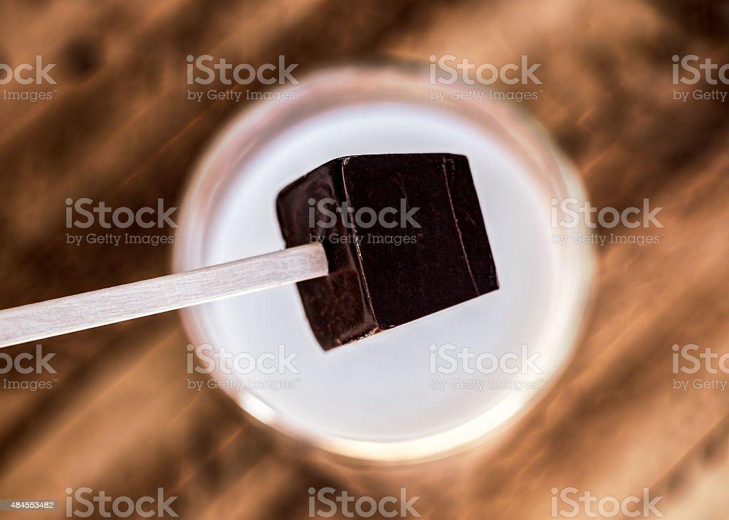 Dark Chocolate Stirrer stock photo