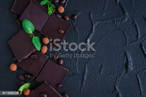 istock Dark chocolate with coffee beans 911535226