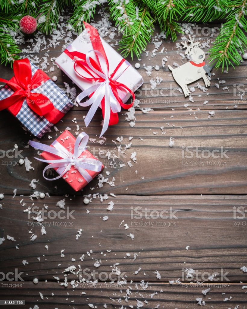 Dark Christmas background. Gifts and congratulations on the New Year. Family meeting. stock photo
