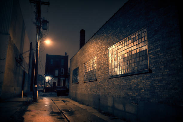 Dark City Alley at Nigh Dark urban city alley at night alley stock pictures, royalty-free photos & images