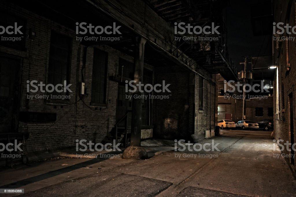 Dark City Alley at Night stock photo