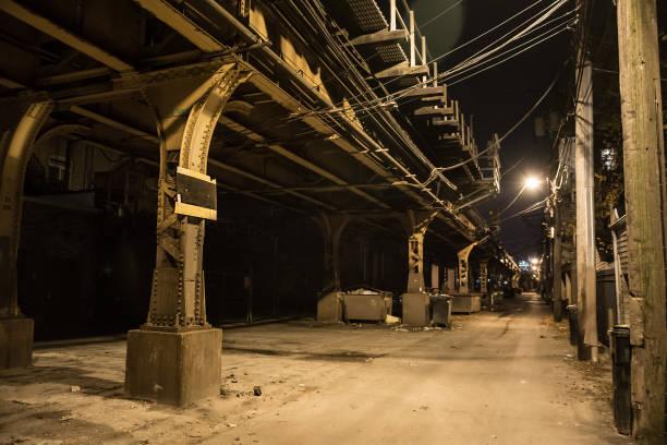 Dark city alley at night. stock photo