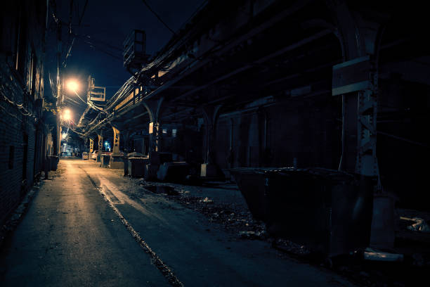 Dark City Alley Dark Urban Alley at Night alley stock pictures, royalty-free photos & images