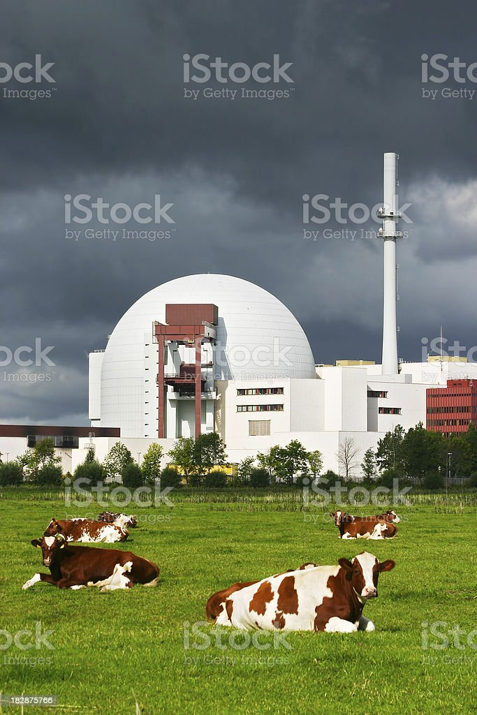 Dark clouds above nuclear power station stock photo
