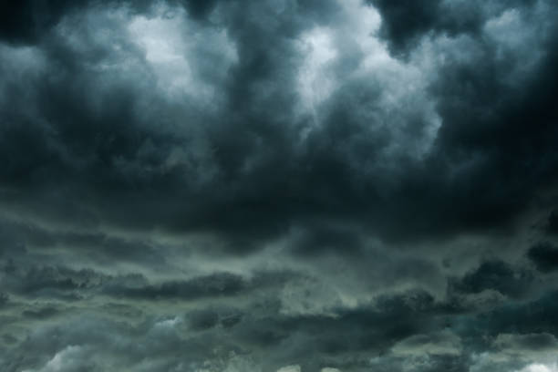 dark clouds and thunderstorm with rainy, dramatic  black clouds in summer - cielo minaccioso foto e immagini stock