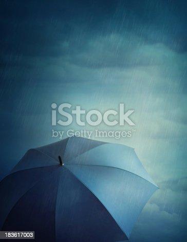 istock Dark clouds and umbrella 183617003