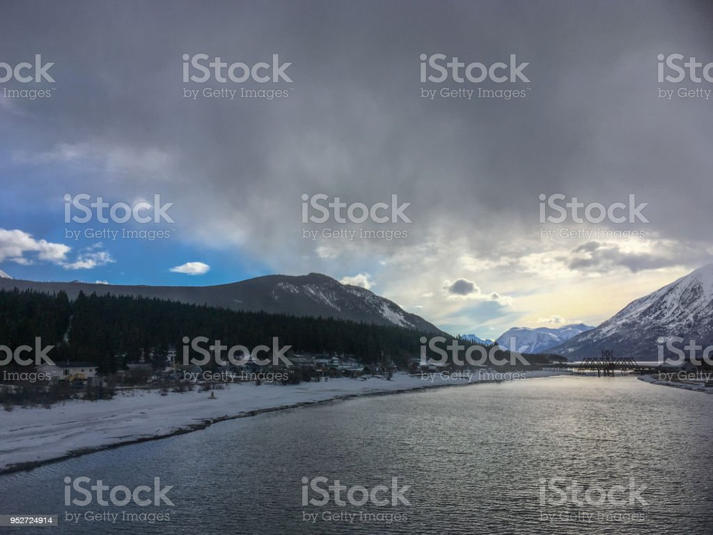 Dark clouds gather over a Yukon Territory village. stock photo
