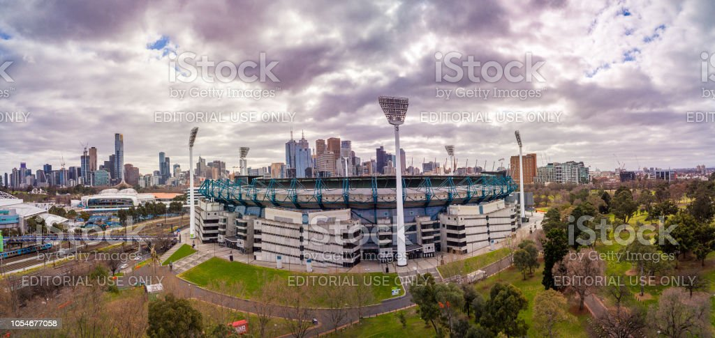 Dark clouds looming over the Melbourne Cricket Ground stock photo