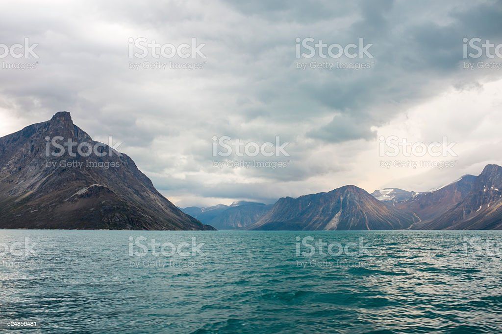 Dark clouds over mountains stock photo