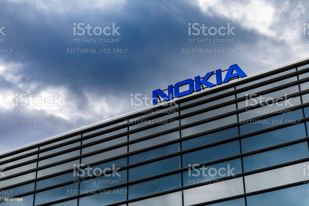 Dark clouds over Nokia logo on top of a building