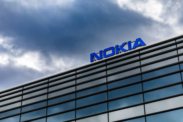 Dark clouds over Nokia logo on top of a building stock photo