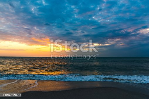 Dark clouds over the sea in Naples at sunset. Florida, USA