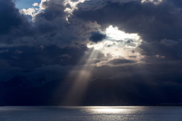 Dark clouds over the sea Dark clouds over the sea emergence stock pictures, royalty-free photos & images