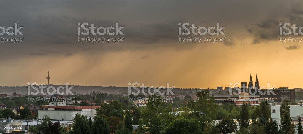 Dark clouds with thunderstorm above Regensburg, Germany stock photo