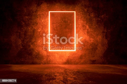 istock Dark concrete background with illuminated frame 668459274