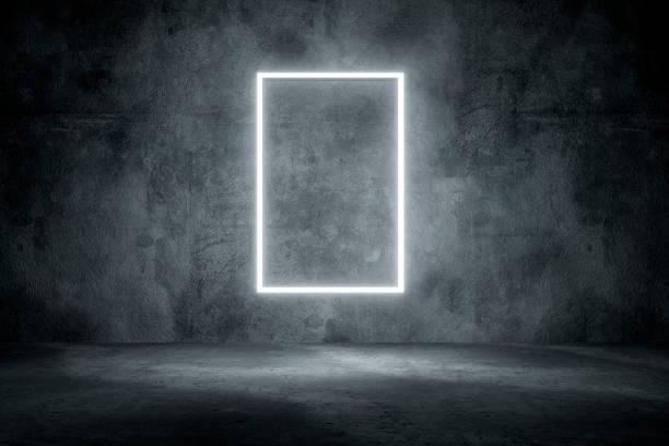 Dark concrete background with illuminated frame stock photo