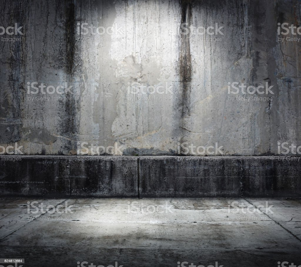 Dark concrete environment with top illumination stock photo