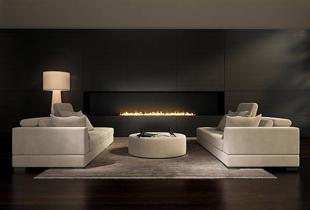 dunkle moderne wohnzimmer mit kamin - gaskamin stock-fotos und bilder