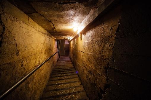 Dark corridor of old underground Soviet bunker under military artillery fortification