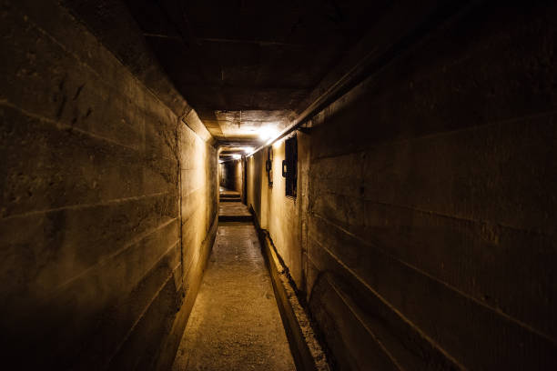 Dark corridor of old underground Soviet military bunker under artillery fortification. Dark corridor of old underground Soviet military bunker under artillery fortification., Sevastopol, Crimea. bomb shelter stock pictures, royalty-free photos & images