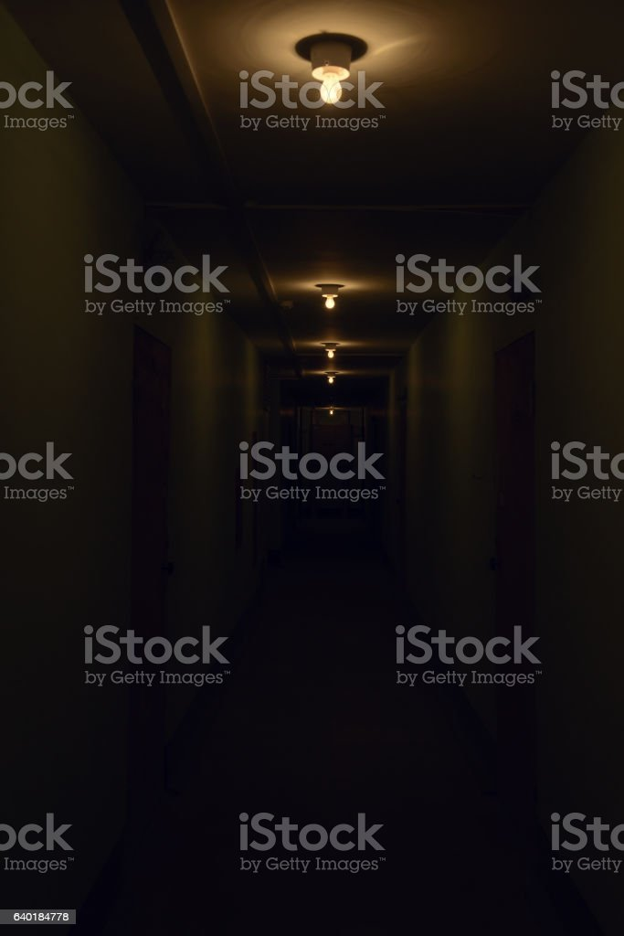 dark corridor with glowing lamps on the ceiling – Foto