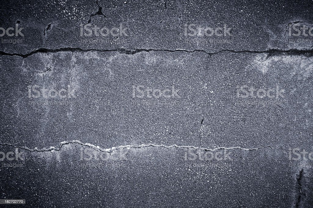 dark cracked concrete wall stock photo