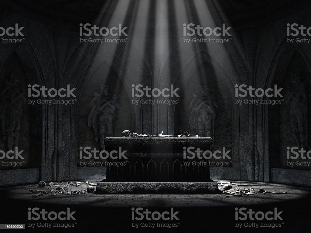 Dark crypt with a creepy altar stock photo