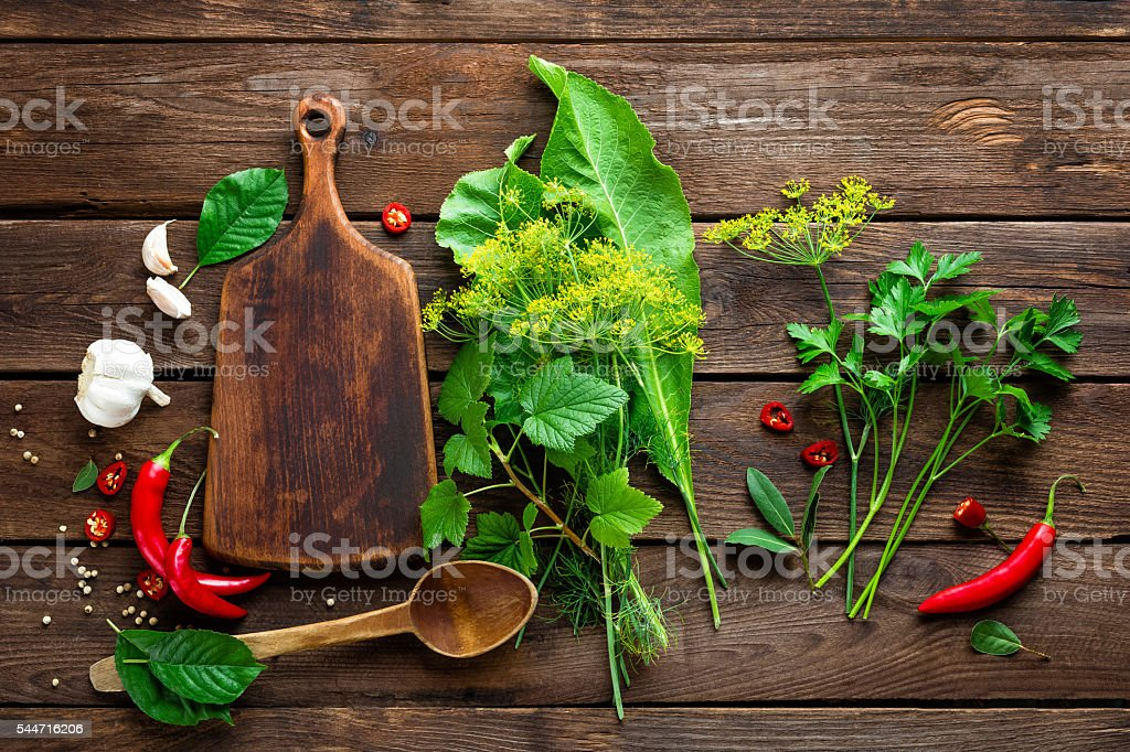 dark culinary background with different herbs and spices, top view stock photo